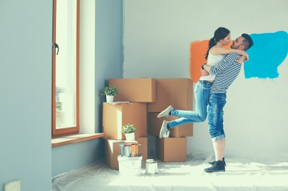 Guy and girl embracing as they get their new home