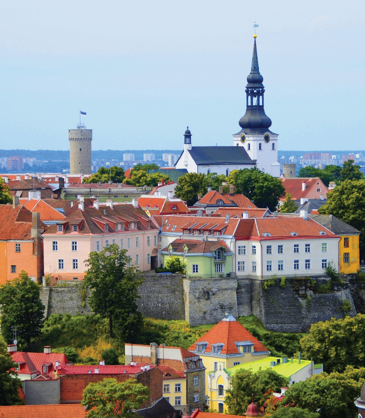 Image of the Estonian capital, Tallinn and it's old rooftops and Estonian flag