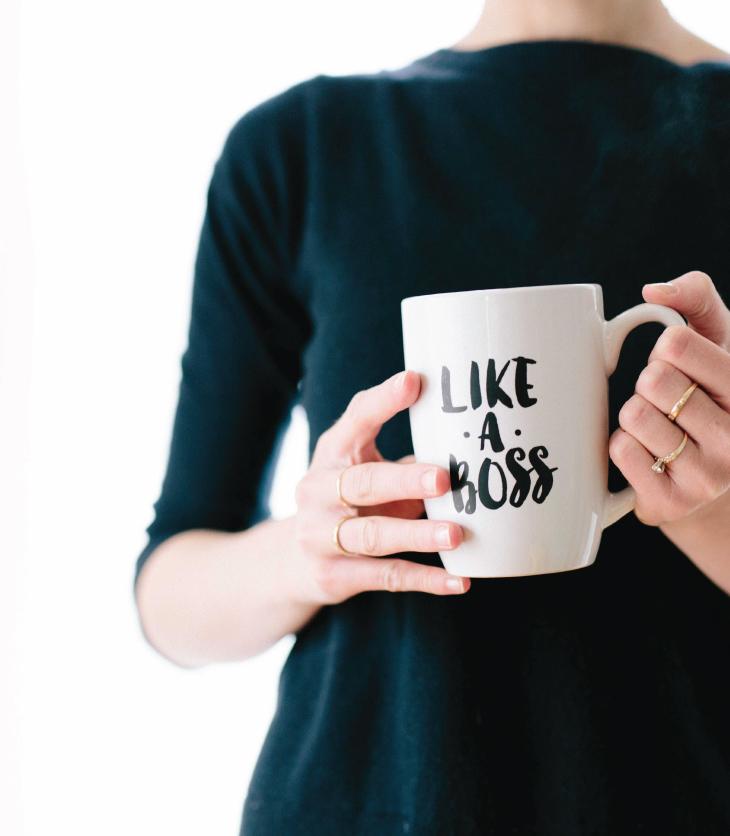 Woman Holding a Mug that Says Like a Boss